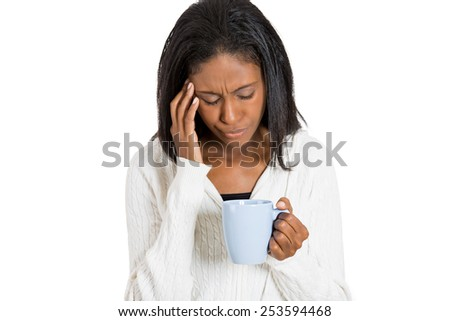 Tired stressed sad woman looking at cup of coffee isolated on white background  - stock photo
