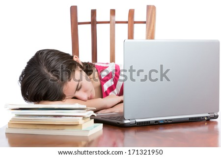 Tired student sleeping on her desk with a laptop computer and books (isolated on white) - stock photo