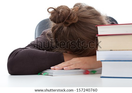 Tired student taking a break in learning with the heap of books - stock photo