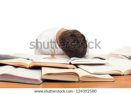 Tired Teenager lying and sleeping on the School Desk. Isolated On the White Background - stock photo