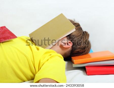 Tired Teenager sleep on the Books - stock photo