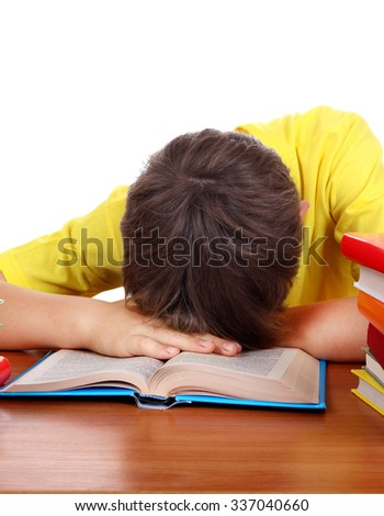 Tired Teenager Sleep on the School Desk on the White Background - stock photo