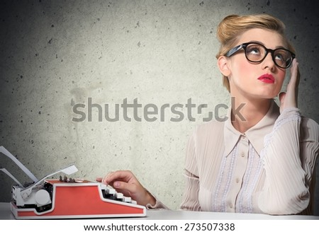 Tired. Too much work tired sleepy young woman sitting at her desk with books in front of laptop computer isolated grey wall office background. Busy schedule in college, workplace, sleep deprivation - stock photo