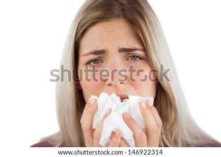Tired woman having a flu and using handkerchief - stock photo