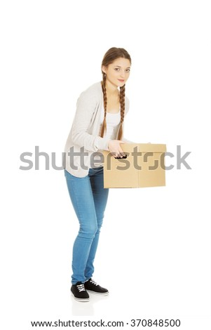 Tired woman holding carton box.