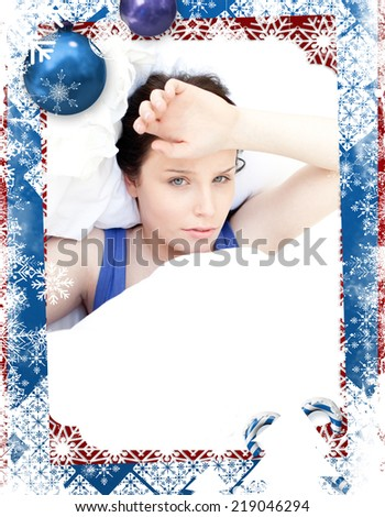 Tired woman relaxing in her bed against christmas themed frame - stock photo