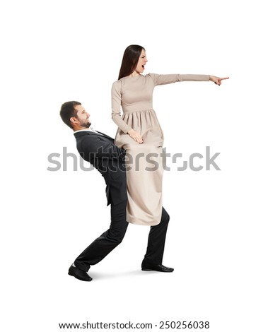 tired young man holding beautiful yelling woman and going forward. isolated on white background - stock photo