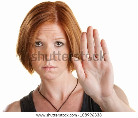 Tired young white woman with hand gesture for stop - stock photo