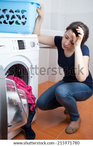 Tired young woman during doing housework, vertical - stock photo
