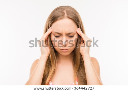 Tired young woman suffering from headache
