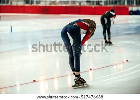 tired young women speed skaters after finish of sprint race