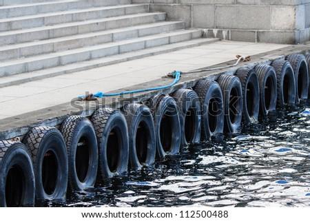 Tires cushion at the docks of Copenhagen - stock photo