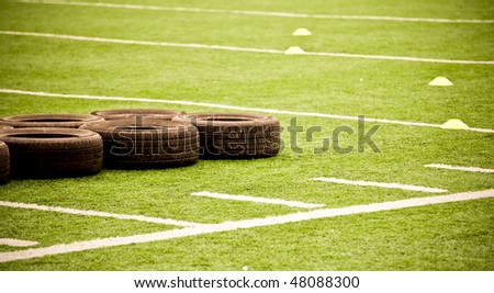 Tires On Football Field at Team Practicde - stock photo