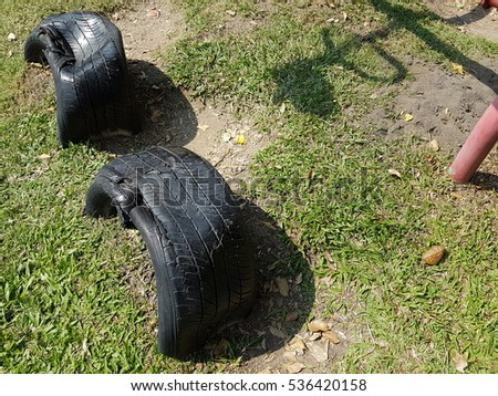 Tires on green grass field