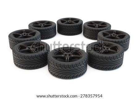 tires on light-alloy wheels lie around - stock photo