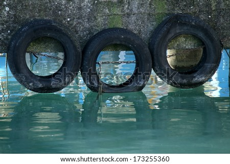 tires on the pier - stock photo