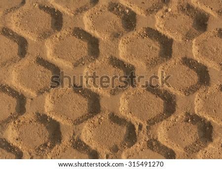 Tires tracks on sand. Texture - stock photo