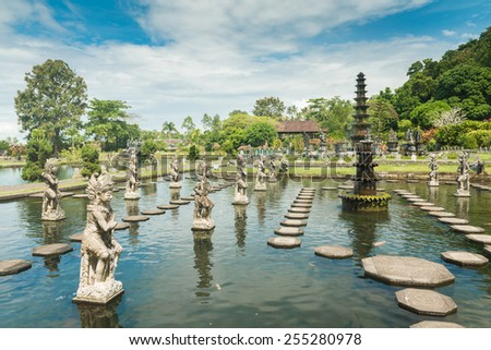 Tirtagangga water palace with fountains  and ponds on Bali, Indonesia - stock photo