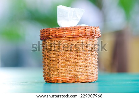 Tissue pepper in basketry bamboo box - stock photo