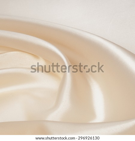 tissue, textile, cloth, fabric, material, texture. beige color. cloth, typically produced by weaving or knitting textile fibers. - stock photo