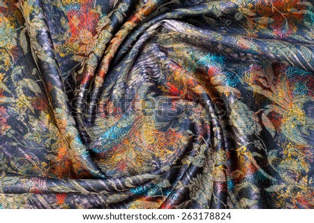 tissue, textile, cloth, fabric, material, texture. Textile stuffed with blue flowers.  cloth, typically produced by weaving or knitting textile fibers. - stock photo