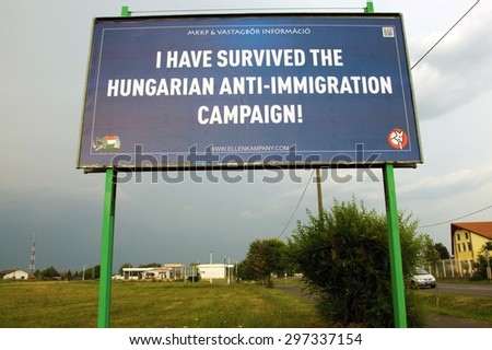 TISZAVASVARI, HUNGARY - JULY 17, 2015: A Hungarian joke party's billboard campaign against the Hungarian government's anti-immigration billboard campaign. Funny political message.
