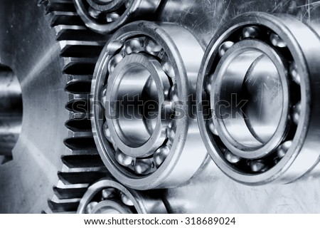 titanium and steel ball-bearings and gears in metallic selenium toning. - stock photo
