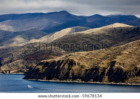 Titicaca. Bewitching view from sun island on Titicaca lake  and the ship floating on him. - stock photo