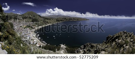 titicaca lake high altitude in andes between Bolivia and Peru city of Copacabana near isla del sol and Isla de la luna sunny day with nice white clouds in blue sky and water panorama with copy space - stock photo