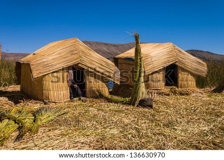 Titicaca lake Peru Uro 2 huts - stock photo