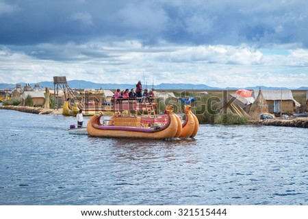 TITICACA, PERU, MARCH 19, 2015: Traditional village on floating Uros  islands on lake Titicaca in Peru, South America  - stock photo
