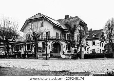TITISEE, GERMANY - DECEMBER 17, 2014: Titisee Village in the German Black Forest. Vintage Black and White winter picture