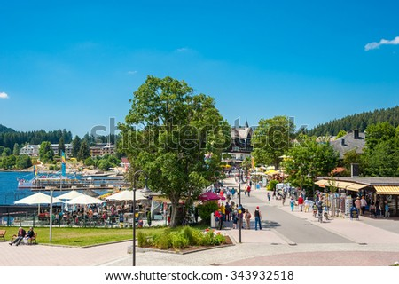 TITISEE-NEUSTADT, GERMANY - JUNE 21, 2014: The promenade in Titisee-Neustadt, Black Forest, Baden-Wuerttemberg, Germany, Europe