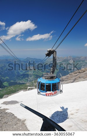Titlis, Switzerland, 12 July, 2011. Cablecar to Mt. Titlis in Switzerland. The weather is very nice with blue sky and cloud. Cablecar is the easiest way to go to the peak of Titlis.