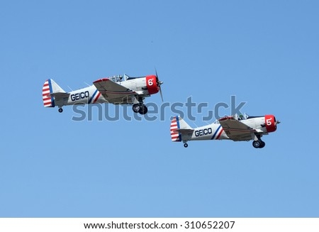 TITUSVILLE - MARCH 15, 2015: Members of the Geico Skytypers aerobatic team depart from Titusville, Florida on March 15, 2015 on the way to an airshow
