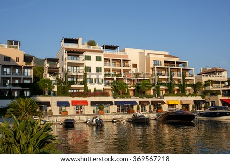 Tivat, Montenegro  - August 30, 2015: Hotels, shops and yachts in a luxury yacht marina in Porto Montenegro, a popular touristic attraction in Adriatic sea  - stock photo
