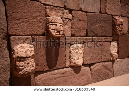 Tiwanacu, Old sculptures near famous lake Titicaca, Bolivia, (shallow depth of field image) - stock photo