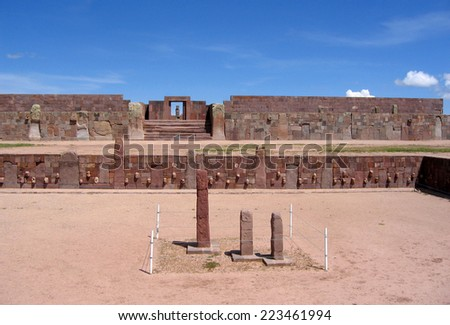 Tiwanaku ruins - pre-Inca Kalasasaya & lower temples. The Kontiki monolith & the many human races created by Viracocha in the lower temple, aligned with the Ponce Monolith at the Kalasasaya main door. - stock photo