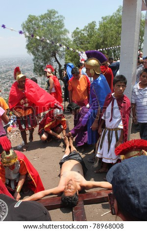 TLALNEPANTLA, APRIL 22: Actors portray the life of Christ during traditional Easter procession in Tlalnepantla, Mexico on Aprill 22, 2011.