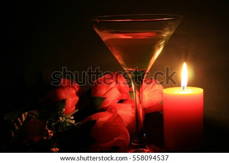 To celebrate Valentine's Day,Romantic Love,A bouquet red roses with pink wine near the candlelight.