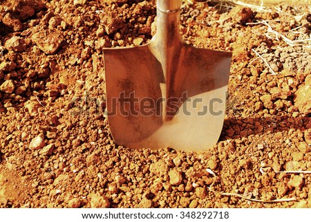 To dig in the sand.Shovel. - stock photo