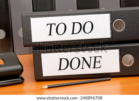 To Do and Done - Two binders on desk in the office - stock photo