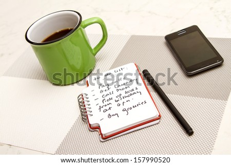 To do list meanwhile having a coffee  - stock photo