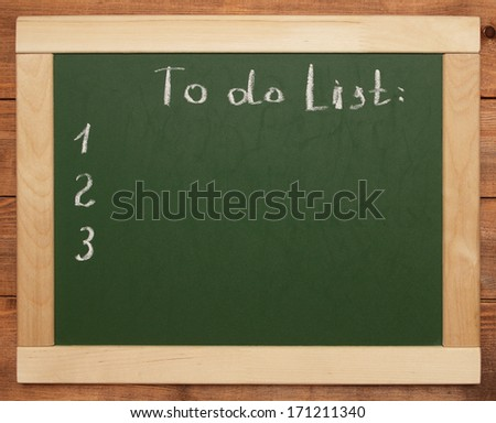 to do list on blackboard - stock photo