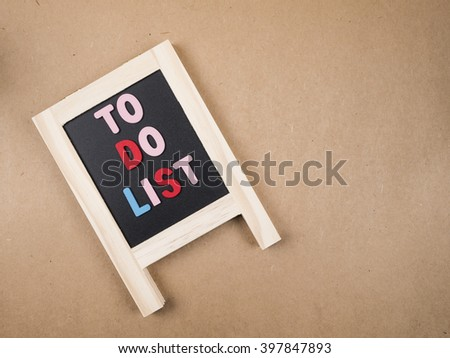 To do list on blackboard on brown paper background (Business Concept)