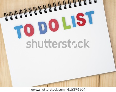To do list on notebook on wood background (Business Concept) - stock photo