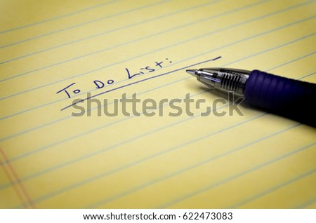 To do list on paper pat with pen in ink