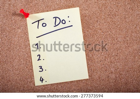 To Do List pinned to a noticeboard. - stock photo