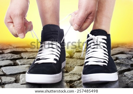 To lace up sports shoes. - stock photo
