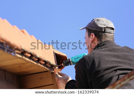 To repair the roof, worker - stock photo